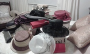 variety of hats and clutch bags